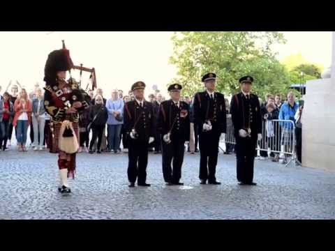 The Menin gate - Ypres - Last post ceremony, piper. Flowers of the forest.