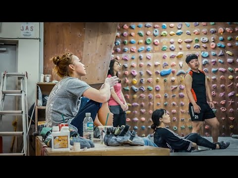 Inside look at Jain Kim rock climbing training in her family owned basement gym