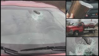 Attleboro woman suffers minor injuries after piece of metal crashes through car windshield