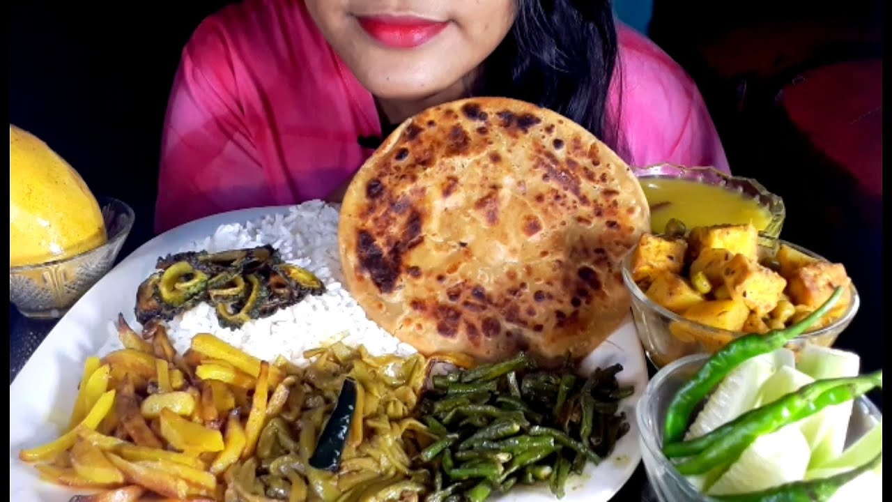 Eating Aloo Paratha, Matar Paneer, Daal, Aloo Bhaji, karela Bhaji ,Beans Bhaji, Sapla Bhaji, Aam