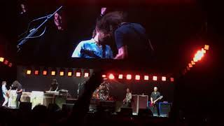 Dave Grohl invited Rick Astley onstage to play an awesome rendition...