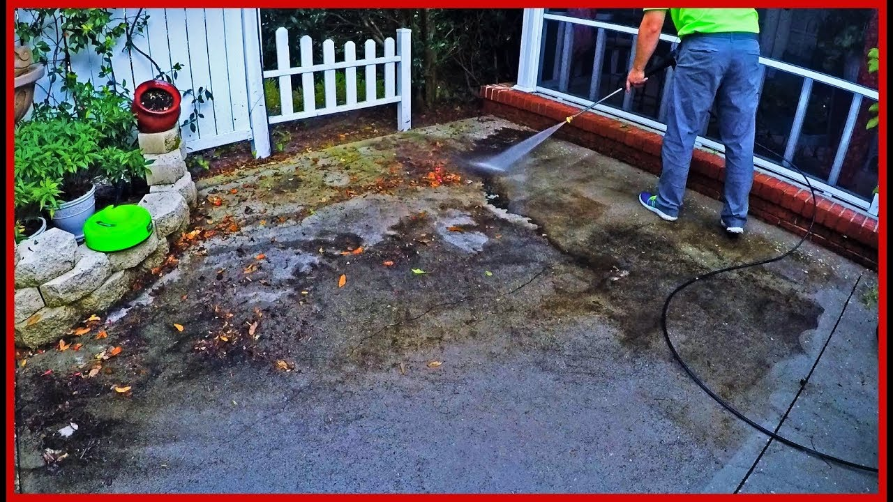 pressure washing the filthy patio satisfying