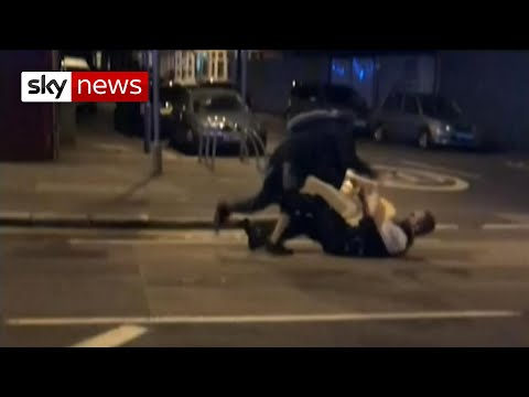 The moment a police officer is attacked with a machete