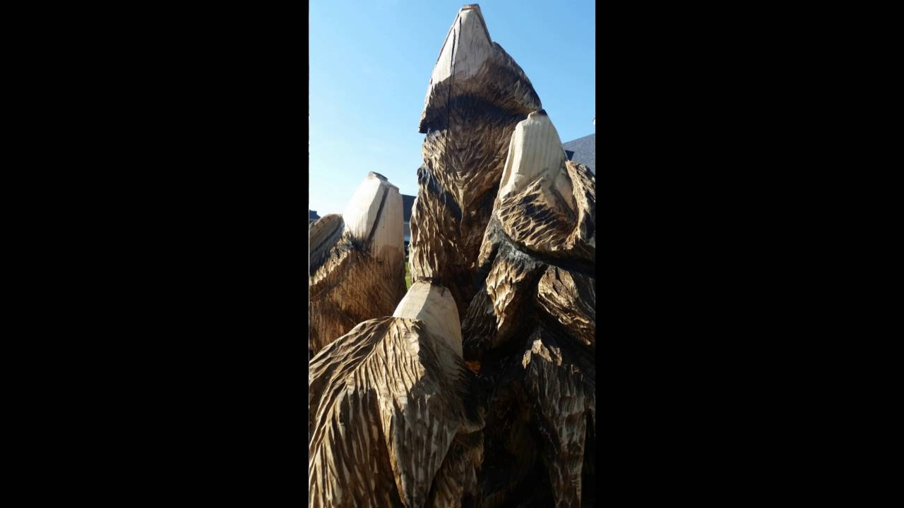 Chainsaw carved wolf pack doovi