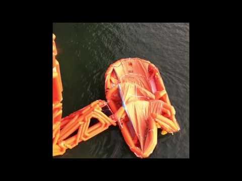 QE-class carrier marine escape system