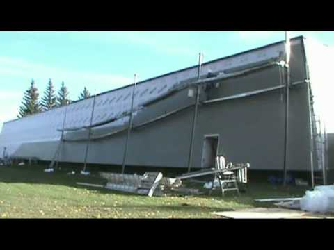 Installing Cement siding on an Arena