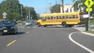 Driver passing school bus with flashing red lights