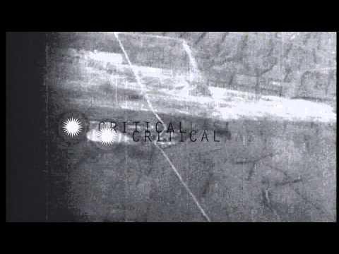 Planes from USS Essex (CV-9) strike Eiko airstrip, Taiwan during World War II. HD Stock Footage