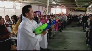 Mexican priest uses watergun to spray holy water