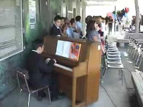 Aaron plays Piano at School Culmination June09