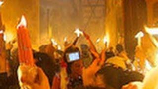 В Иерусалиме сошел Благодатный огонь 19.04.2014(В Иерусалиме в храме Гроба Господня свершилось кульминационное священнодействие, традиционно предваряюще..., 2014-04-19T13:59:01.000Z)