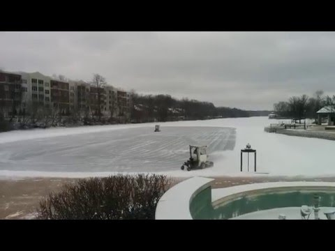 Preparation of open air  ice rinks on Fox river in  Batavia, Illinois.