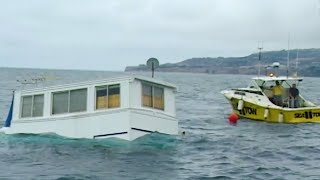 House Boat Sinks Beneath Waves of Water