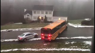 School bus slides down icy road in Massachusetts, crashes into car