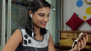 Smiling Indian girl doing a video call with her parents while in office