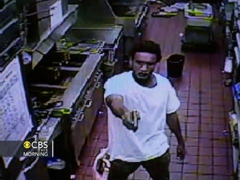 Watch: Gunman's weapon jams at McDonald's
