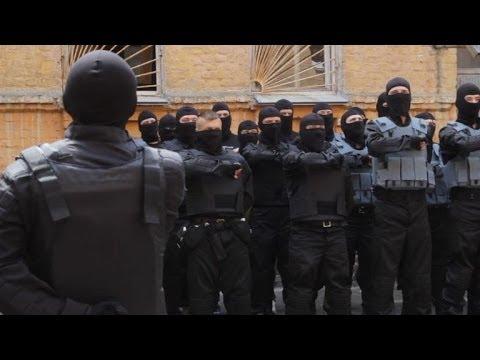 Volunteers with Ukraine's 'Pravy Sektor' head east to fight