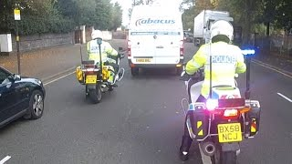 Police bikes escorting vans through Birmingham