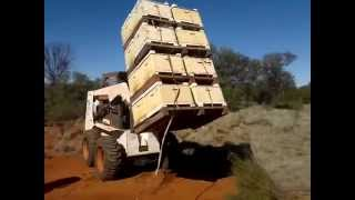 loading and unloading hives. professional beekeeping