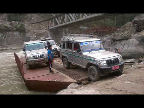 Crossing the Arun River on a ferry in Sankhuwasabha, Nepal
