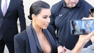 Kim Kardashian Signs Autographs For Fans Outside The Jimmy Kimmel Show