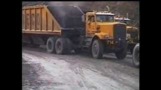 Trucks on a very abusive coal haul in Indonesia.