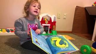 Cora reads Pete the Cat and His 4 Groovy Buttons