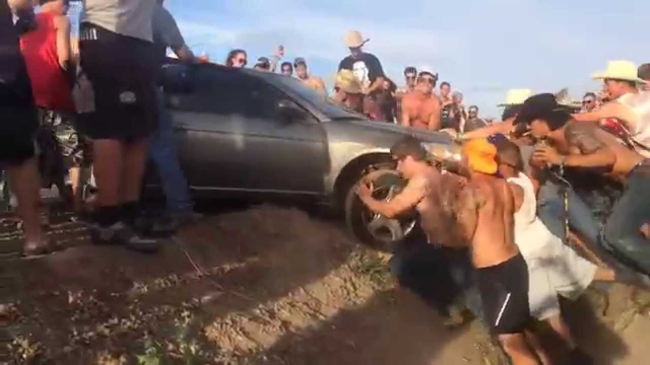 Men Help Lift Car Out Of A Ditch At Country Thunder 2014 In Arizona