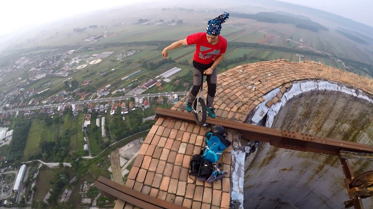 Unicycle On Huge Chimney In Targu Jiu YouTube - Crazy guy base jumps radio tower