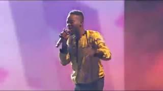 Adekunle Gold Performing