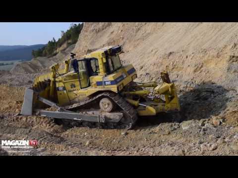 Dozer Caterpillar  CAT D9T pushing dirt down to quarry