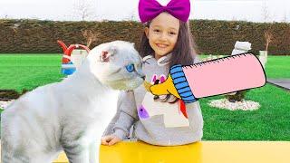 Öykü feeds the cat - fun kids video