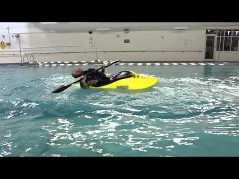 learn how to back deck roll a kayak