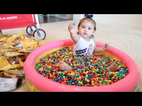 BABY COVERED IN 1 MILLION M&Ms!!!