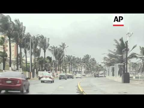 +4:3 Tropical storm Ernesto makes its way inland