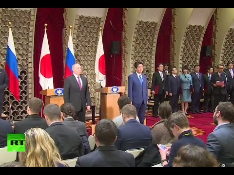 Putin & Abe holding joint news conference in Tokyo