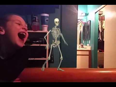 William laughing at a skeleton  dancing