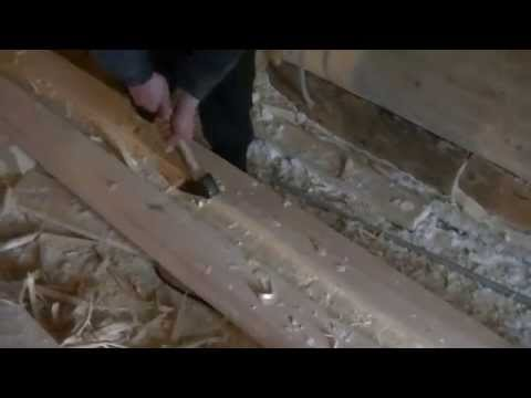 Longitudinal groove in a log. Cabin of a groove with teslo. Construction of the wooden house.