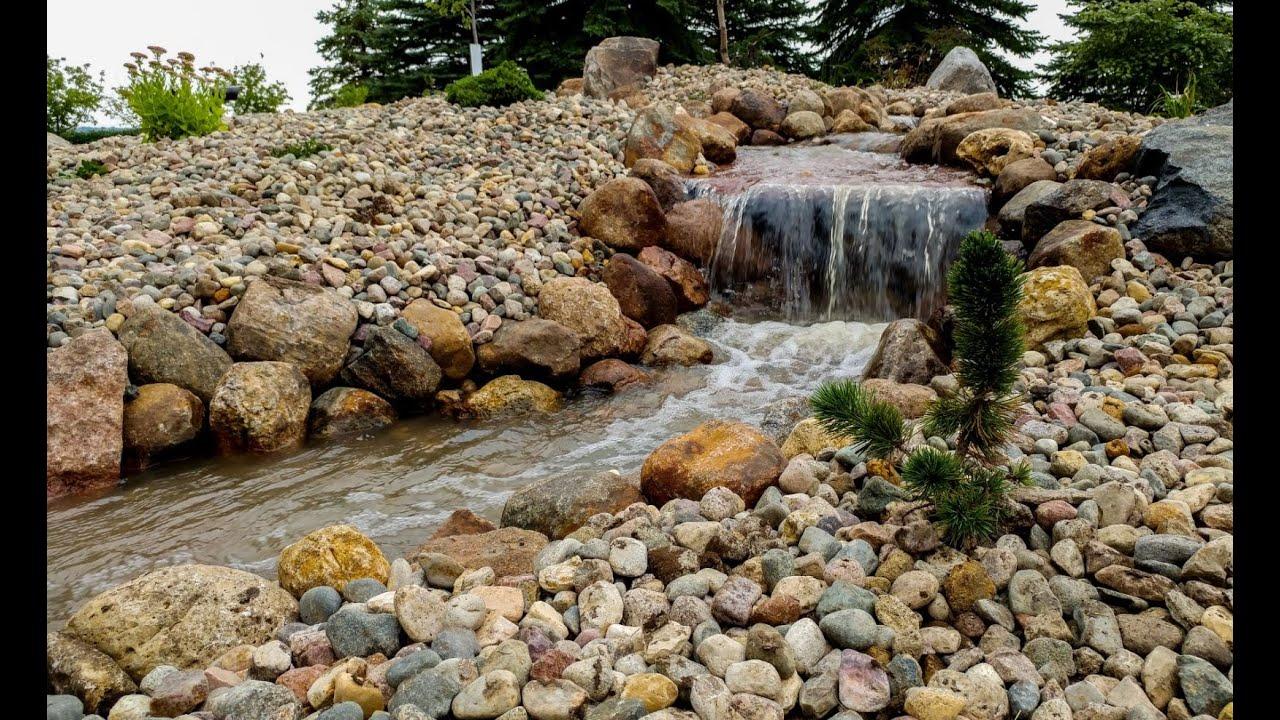 Building a backyard waterfall time lapse - YouTube