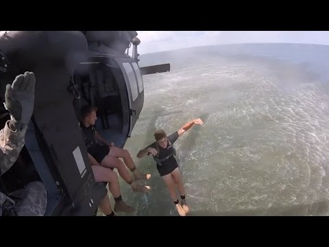 U.S. Army Rangers from 1st Battalion, 75th Ranger Regiment, jump from 3rd Combat Aviation Brigade UH-60M Black Hawk and CH-47F Chinook helicopters during water insertion training off the coast of Tybee Island, Georgia, July 20. ‪  Video by Spc. Scott Lindblom, 3rd Combat Aviation Brigade
