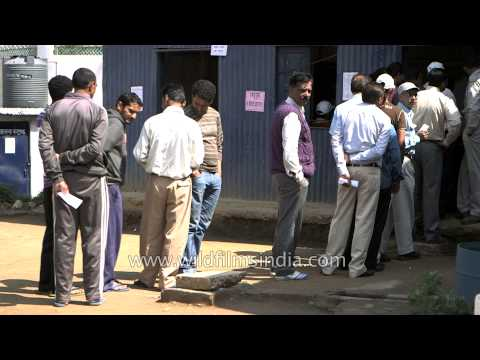 India votes - people queue up to exercise their voting right in Lohaghat town