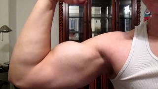 16 year old bodybuilder flexing and measuring arm
