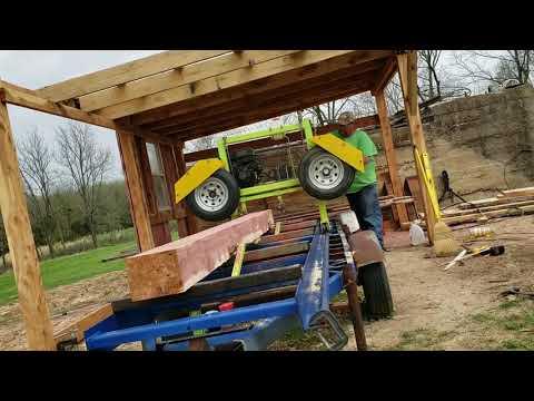 My homemade bandsaw sawmill sawing cedar