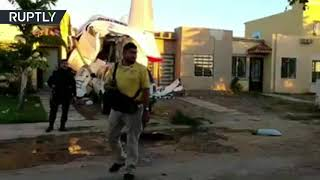Aftermath of Cessna plane plowing into home, at least 4 killed