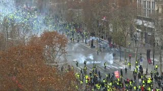 Police fire tear gas on Champs-Elysees