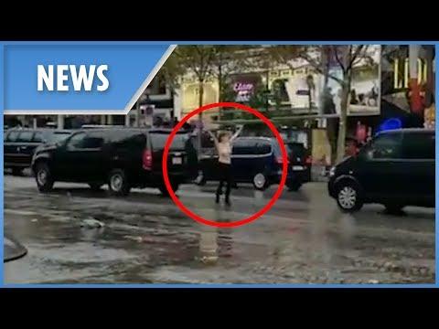 Topless activist throws herself at Trump's motorcade