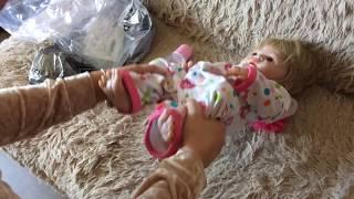 Обложка на видео о Распаковка посылки с сайта AliExpress, винил - силиконовая кукла  reborn