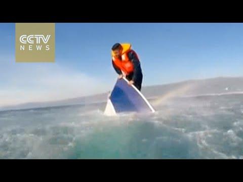 Footage: Turkish coast guard rescues desperate refugee