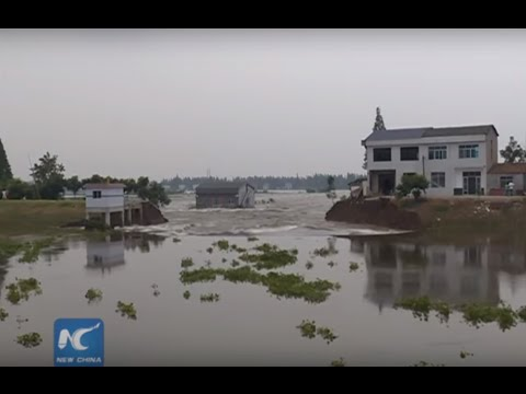 Aerial view of levee repair after rain-triggered breach in C China