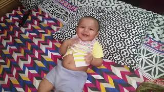 Sweet little baby laughing and playing